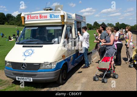 People queuing up at ice cream van on Hampstead Heath, London, England, UK - Stock Photo