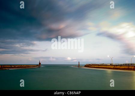 Long exposure of the sunrise over deserted harbor - Stock Photo