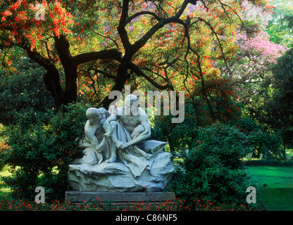 Statue and colorful vegetation at Retiro Plaza San Martin in central Buenos Aires - Stock Photo