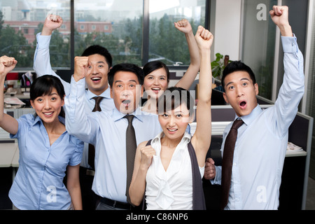 Colleagues Cheering Together - Stock Photo