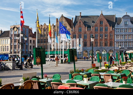 Bars, cafes, restaurants, and tourists in the Grote Markt or Market Square in Bruges, (Brugge), Belgium - Stock Photo