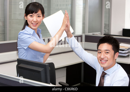 Colleagues High-Fiving - Stock Photo