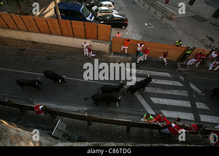 Running of the bulls Encierro at the San Fermin Festival in Pamplona, Navarre, Spain. - Stock Photo