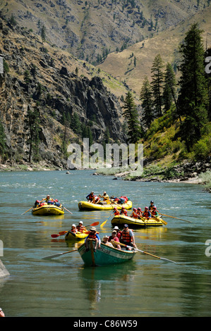 Rubber paddle boats, gear boat, dory and inflatable kayaks with the O.A.R.S. group on Main Salmon River in Idaho - Stock Photo