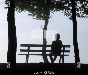 Silhouette of Woman Sitting on Bench, Calmont, Bremm, Cochem-Zell, Rhineland-Palatinate, Germany - Stock Photo