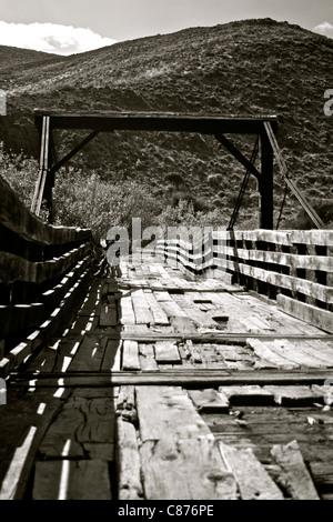 View of El Puente Negro (The Black Bridge) across the Chimehuín river in Patagonia, Argentina - Stock Photo