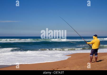 Fishing from the beach at Amanzimtoti, KwaZulu-Natal, South Africa. - Stock Photo