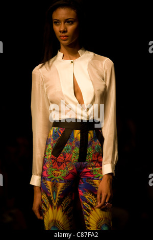 A model wearing a desing by Centro walks along the catwalk during Mexico City Fashion Week 2011, on September 26, - Stock Photo