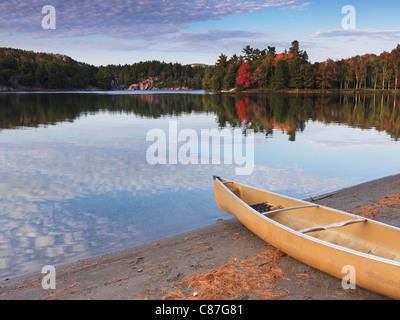 Canoe on a shore of George lake. Beautiful fall nature scenery. Killarney Provincial Park, Ontario, Canada. - Stock Photo