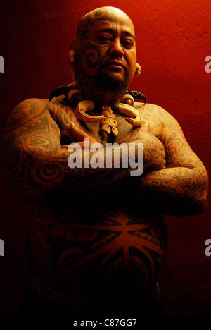 A Maori tattoo artist at the Tattoo Convention, Dresden, Germany - Stock Photo