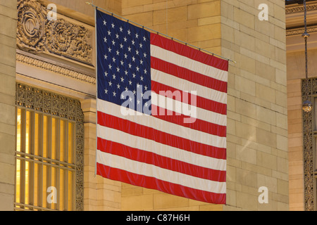 The large American flag hanging in Grand Central Terminal in New York City - Stock Photo