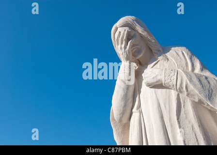 'And Jesus Wept' sculpture stands across from Oklahoma City National Memorial in Oklahoma City, Oklahoma, USA - Stock Photo