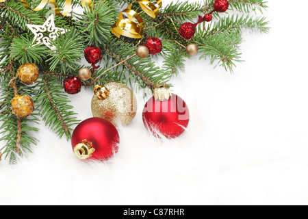 Christmas ornaments on white fluff . - Stock Photo