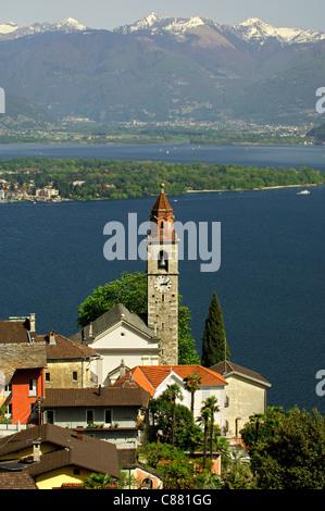 Ronco sopra Ascona at the lake Lago Maggiore, the Magadino Plain and the Lepontine Alps behind, Ticino, Switzerland - Stock Photo
