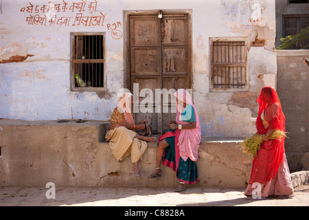 Indian local women in Narlai village in Rajasthan, Northern India - Stock Photo
