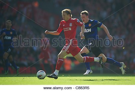 LIVERPOOL, ENGLAND - Saturday, October 15, 2011: Liverpool's Lucas Leiva in action against Manchester United's Phil - Stock Photo