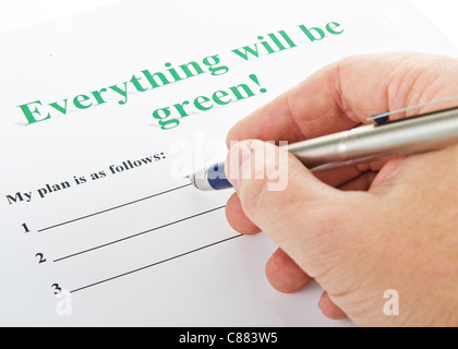 man's hand with a fountain pen on the plan 'Everything will be green !' - Stock Photo