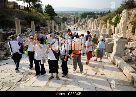 Tourists in Ephesus, UNESCO World Heritage Site, looking down Curetes Street to the Library of Celsus, Selcuk, Western - Stock Photo