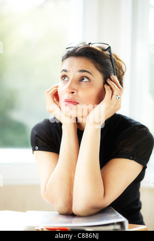 Woman stressed in office - Stock Photo