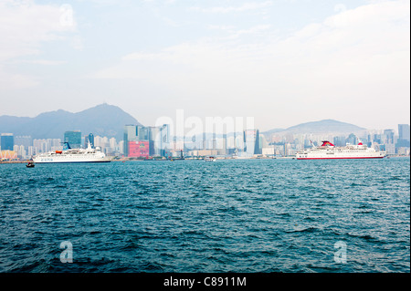 Cruise Ships Anchored in Victoria Harbour near Kowloon Hong Kong China Asia - Stock Photo