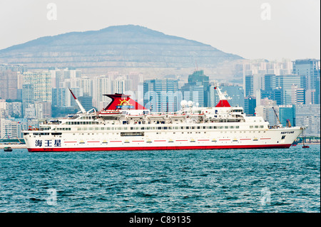 Cruise Ship Anchored in Victoria Harbour near Kowloon Hong Kong China Asia - Stock Photo