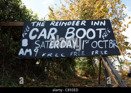 Incorrect spelling on a roadside sign advertising a car boot sale in the U.K. - Stock Photo