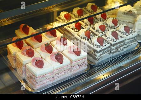 Strawberry cream cakes in patisserie, London, UK - Stock Photo