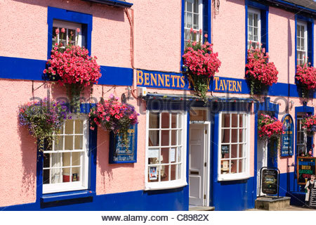 Colourful window boxes on Public House Fishguard Pembrokeshire Wales - Stock Photo