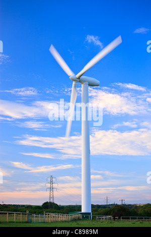 Wind turbine in the evening light - Stock Photo