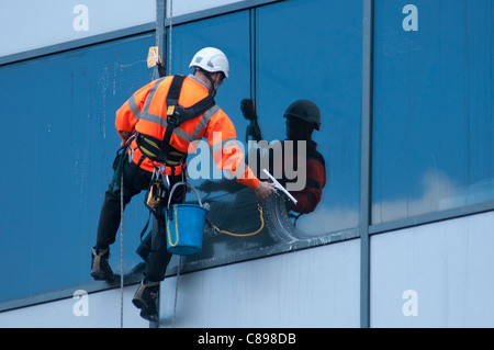 A window cleaner at work on an office building in Birmingham, UK. - Stock Photo
