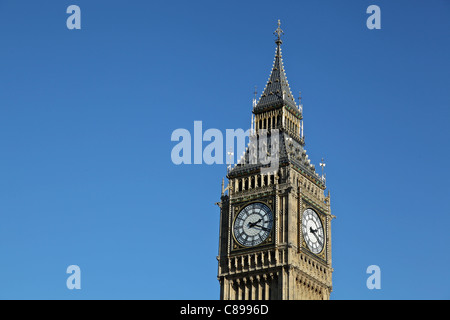 The upper section of Big Ben - the Westminster Palace clock tower. Text on the left. - Stock Photo