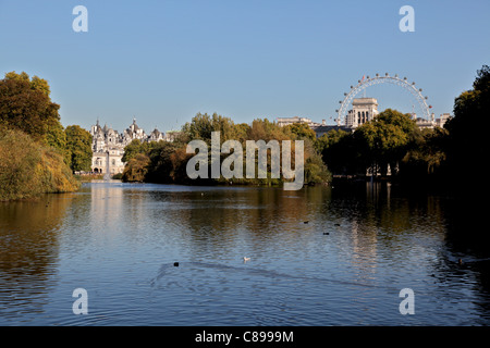 A view over St. James Park Lake with the London Eye & Horse Guards on the right and The Household Cavalry Museum - Stock Photo