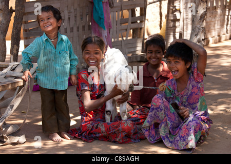 Happy Indian children in typical Rajasthani village of Nimaj, Rajasthan, Northern India - Stock Photo