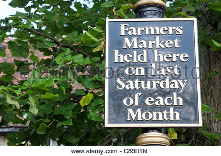 Farmers Market held here on last Saturday of each Month sign in Higham Ferrers, Northampton, England - Stock Photo