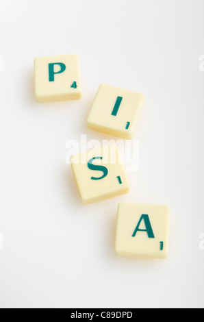 Scrabble game with word 'Pisa' on white background - Stock Photo
