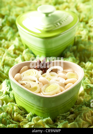 White haricot bean with leeks and lemon balm - Stock Photo