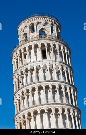 Italy, Tuscany, Pisa, View of Leaning tower against blue sky - Stock Photo