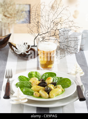 Touquet Ratte potatoes with whelks,snails and spinach shoots - Stock Photo