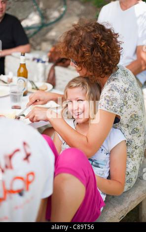 Italy, Tuscany, Family and friends having picnic - Stock Photo