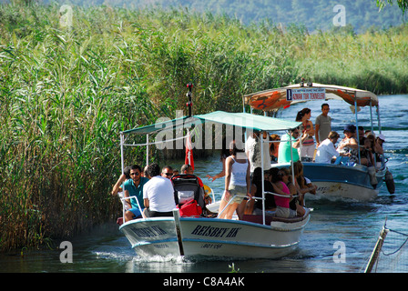 AKYAKA, TURKEY. Pleasure boats taking holidaymakers up the Azmak river in the Gokova conservation area. 2011. - Stock Photo