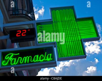 Spanish 'Farmacia' green cross sign outside chemist pharmacy shop in Palma Mallorca Spain - Stock Photo