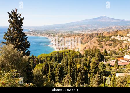 View of Giardini Naxos, Golfo Di Naxos and Mount Etna, from Taormina, Sicily, Italy - Stock Photo