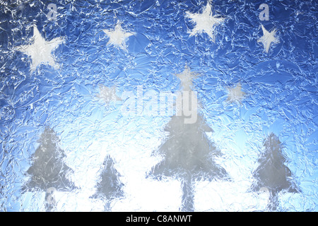 Christmas trees and stars - Stock Photo