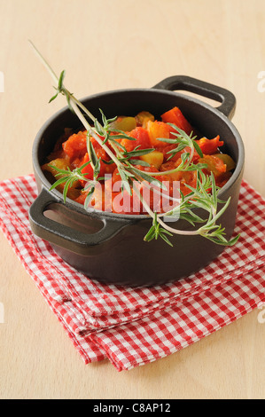 Stewed vegetables with savory - Stock Photo