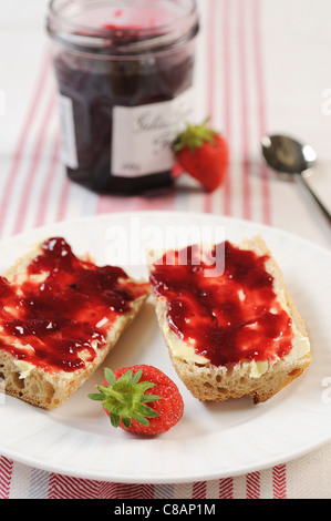 Bread,butter and strawberry jam - Stock Photo