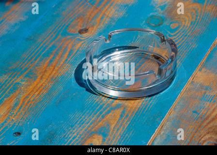 Ashtray on the table - Stock Photo
