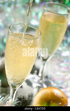Pouring glasses of Champagne - Stock Photo