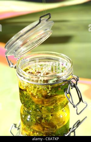 Jars of ceps preserved in olive oil - Stock Photo