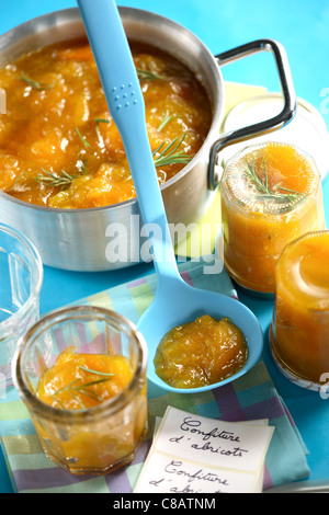 Filling the jam jars - Stock Photo