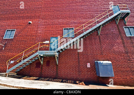 Metal Stairs on brick wall - Stock Photo